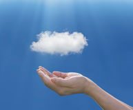 Woman hand holding under cloud on blue background, cloud comput stock images
