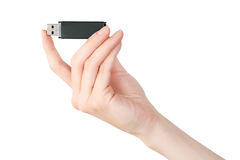 Woman hand holding usb flash memory card Royalty Free Stock Photo