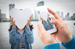 Woman hand holding and using mobile,cell phone,smart phone photography. Woman hand holding and using mobile,cell phone,smart phone photography and heart-shaped royalty free stock image