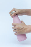 Woman hand holding warm bottle  on white background Royalty Free Stock Photos