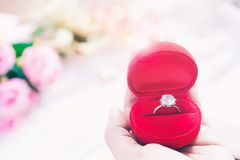 Woman hand holding wedding ring in red box, Wedding or Engagement Concept Royalty Free Stock Image