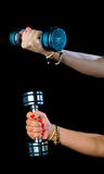 Woman hand holding weights Stock Images