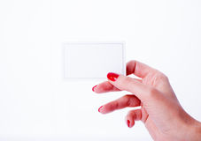 Woman hand holding a white card. On white background Stock Image