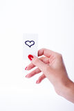 Woman hand holding a white card. On white background, heart Stock Images