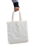 Woman hand holding white cotton fabric bag on  ,save world concept Royalty Free Stock Photography