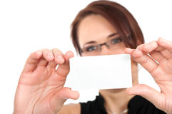 Woman hand holding white empty blank business card. Shallow DOF, face in blur Stock Images