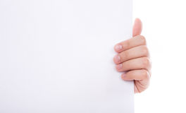 Woman hand holding white empty paper. Woman hand holding white empty paper isolated on white background Royalty Free Stock Images
