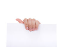Woman hand holding white empty paper. Stock Images