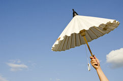 Woman hand holding white umbrella Royalty Free Stock Photography