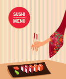 Woman hand  holds by chopsticks maki sushi Stock Photos