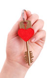 The woman hand holds a key to heart Stock Photos