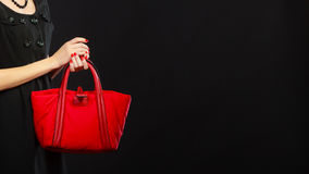 Woman hand holds red handbag Royalty Free Stock Photography