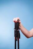 Woman hand holds ski poles. Winter sport Stock Photography