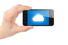 Woman hand holds smart phone with cloud computing concept Royalty Free Stock Photography