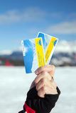 Woman hand holds two skipass Royalty Free Stock Images