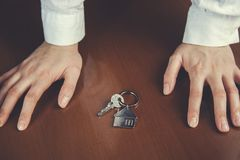 Woman hand house key royalty free stock photos