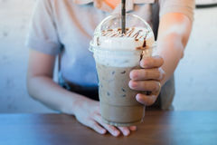 Woman Hand On Iced Milk Coffee Drink Stock Image
