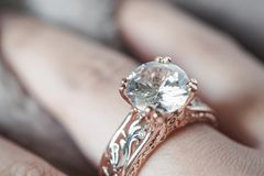 Woman hand with jewelry diamond ring. On finger stock photo