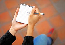 Woman hand jot note Stock Photos