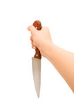 Woman hand with kitchen knife Royalty Free Stock Photo