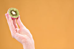 Woman hand with kiwi fruit royalty free stock photos