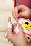 Woman hand is knitting Royalty Free Stock Image