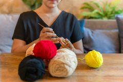 Woman hand knitting crochet at home as hobby. Woman hand knitting crochet at home as hobby stock images