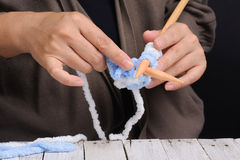 Woman hand knitting by wood knit Royalty Free Stock Photo
