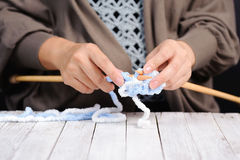Woman hand knitting by wood knit Royalty Free Stock Image