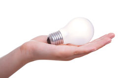 Woman hand with lamp bulb Royalty Free Stock Photos