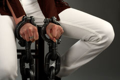 Woman hand in large handcuffs Royalty Free Stock Photo