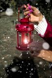 Woman with latern. Woman hand with latern. Christmas background with snow in outdoor Royalty Free Stock Photos