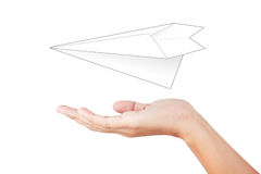 Woman hand launching white paper. Airplane  on white background Royalty Free Stock Photography