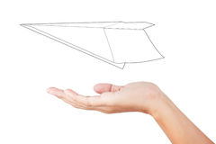 Woman hand launching white paper airplane isolated on white back Royalty Free Stock Image