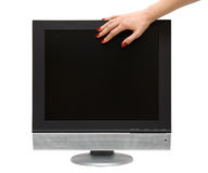 Woman hand on lcd-tv screen Stock Photo
