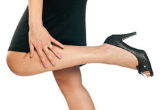 Woman hand and leg Royalty Free Stock Image