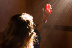 Woman hand into the light Royalty Free Stock Photo