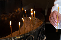 Woman hand lighting candles Royalty Free Stock Photo
