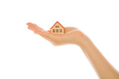 Woman hand with a little house Royalty Free Stock Photos