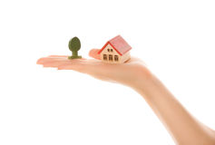 Woman hand with a little house Stock Photos