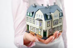 Woman hand with little house Royalty Free Stock Photo