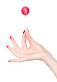 Woman hand with lollipop stock photo