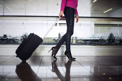 Woman with hand luggage in airport Royalty Free Stock Images
