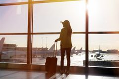 Woman waiting for her flight in airport Royalty Free Stock Photography