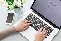 Woman hand MacBook Pro with social networking service Google Stock Images