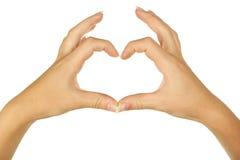 Woman hand making heart. close up Stock Photos