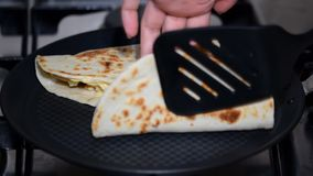 Woman hand is making Homemade traditional Mexican food Quesadillas.  stock video