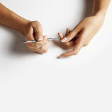 Woman hand making manicure Stock Photos