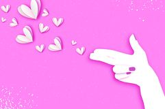 Woman hand making shape of pointed gun.Origami Female holding Two fingers like a revolver. Love Bang. White Hearts Shot. Paper cut style. Valentine day on Stock Photo