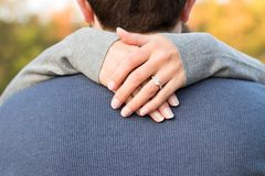 Woman Hand on Man's Neck Royalty Free Stock Photo